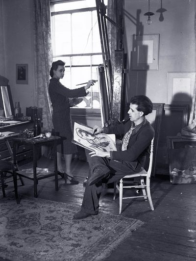 Author and illustrator Mervyn Peake sketches a likeness of his wife painter Maeve Gilmour (Gilmore) while she is working at her easel 1938.  (Photo by General Photographic Agency:Getty Images)